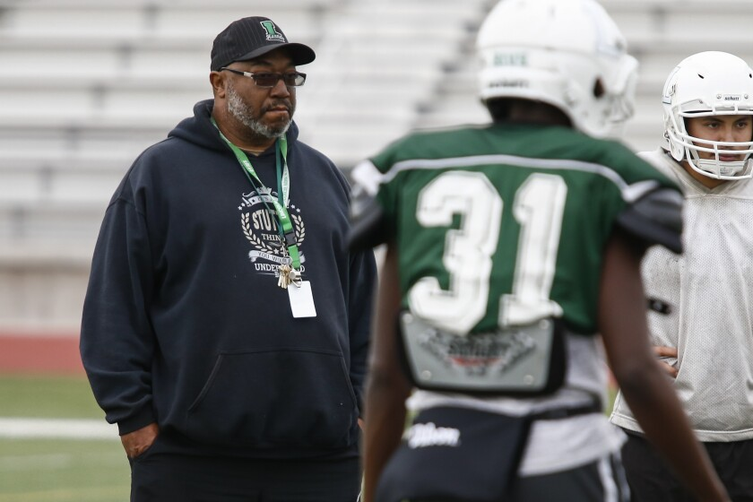 Lincoln High School head football coach David Dunn looks on at practice on Monday, December 10th, 2018, ahead of the Hornets' state championship game on Friday.