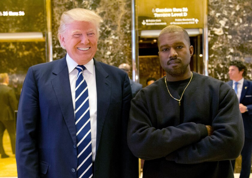 In this Dec. 13, 2016, file photo, then-President-elect Donald Trump and Kanye West pose for a picture in the lobby of Trump Tower in New York.