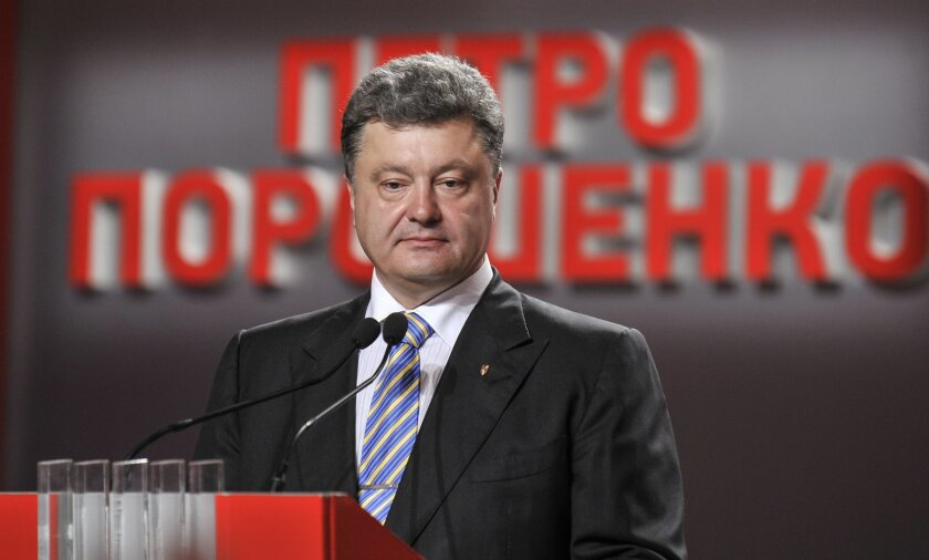 Ukrainian presidential candidate Petro Poroshenko during his press conference in Kiev, Ukraine, Sunday, May 25, 2014. An exit poll showed that billionaire candy-maker Petro Poroshenko won Ukraine's presidential election outright Sunday in the first round — a vote that authorities hoped would unify
