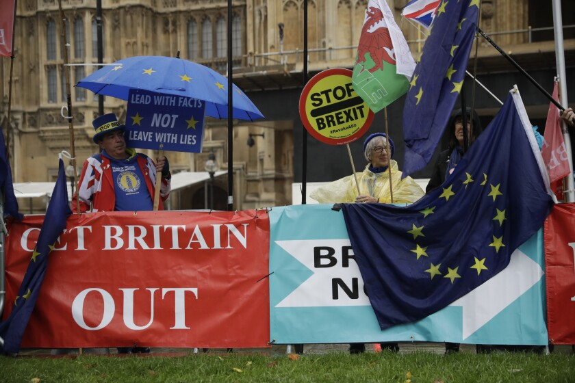 Supporters of Britain remaining in the European Union protest near banners placed by Brexit supporters Oct. 24 outside Parliament.