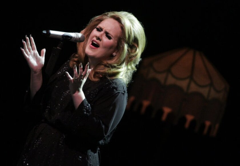 """Adele's """"21"""" is one of just eight albums to sell 10 million copies in their first two years of release. Above, Adele performs at L.A.'s Greek Theatre in 2011."""