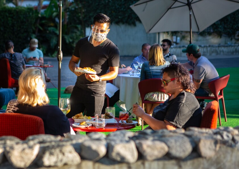 People dine on an outdoor patio