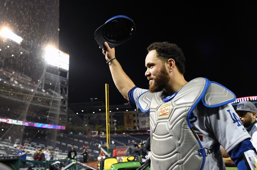 Dodgers catcher Russell Martin acknowledges Dodger fans at Nationals Park following the team's victory in Game 3 of the NLDS on Sunday.