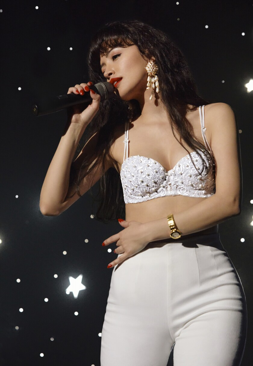 "Christian Serratos portrays singer Selena Quintanilla in Netflix's ""Selena: The Series."""