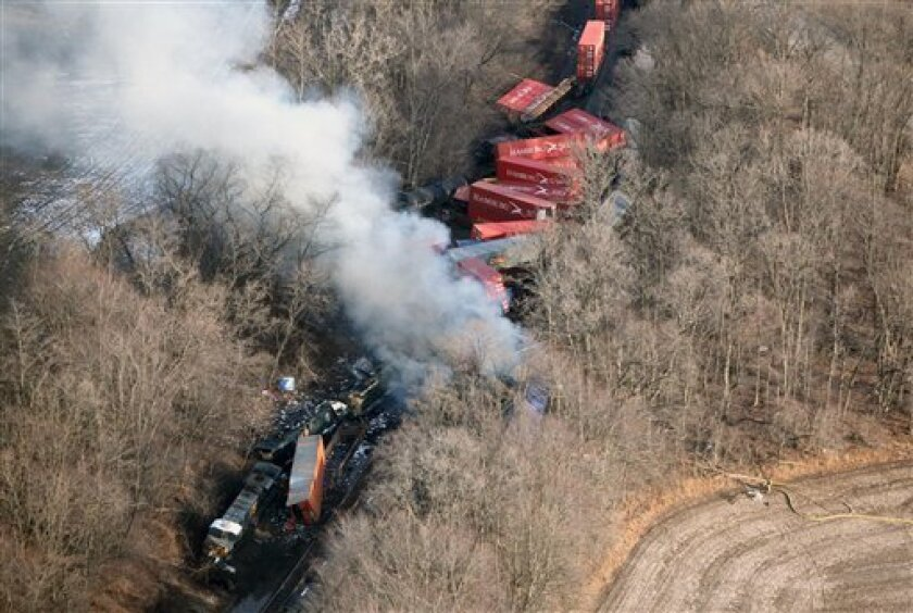 The scene of a freight train collision and derailment is seen, Friday, Jan. 6, 2012 near Valparaiso, Ind. Three freight trains derailed after a collision in northwest Indiana, officials said Friday, leaving several mangled train cars on their sides along the tracks and black smoke billowing from burning tankers. (AP Photo/The Times, John J. Watkins) MANDATORY CREDIT; CHICAGO LOCALS OUT; GARY OUT
