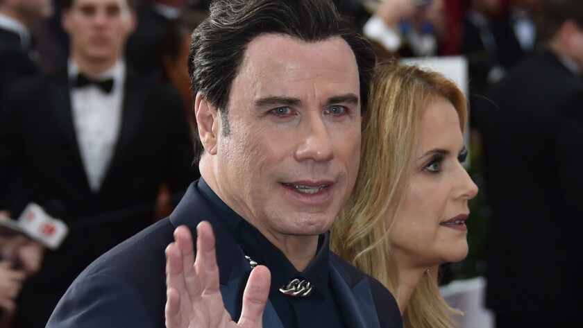 """John Travolta, seen arriving at the Oscars in February with wife Kelly Preston, says his family has """"done so well"""" with Scientology."""