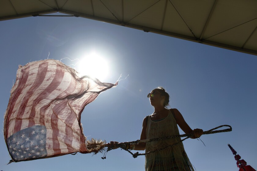 INDIO, CA -- APRIL 20, 2013--Sarah Weston,28, from Venice, attending her first festival, used her American Flag scarf as a flag while dancing to Allen Stone, on day two, of the second week, of the Coachella Valley Music and Arts Festival, at the Empire Polo Club in Indio, April 20, 2013.