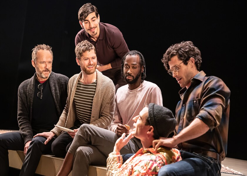 """Six men share sit and share stories in """"The Inheritance"""" on Broadway."""