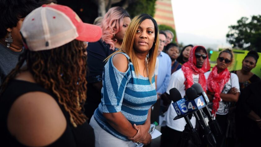 LaTisha Nixon, the mother of Gemmel Moore, speaks at a news conference outside the West Hollywood sh