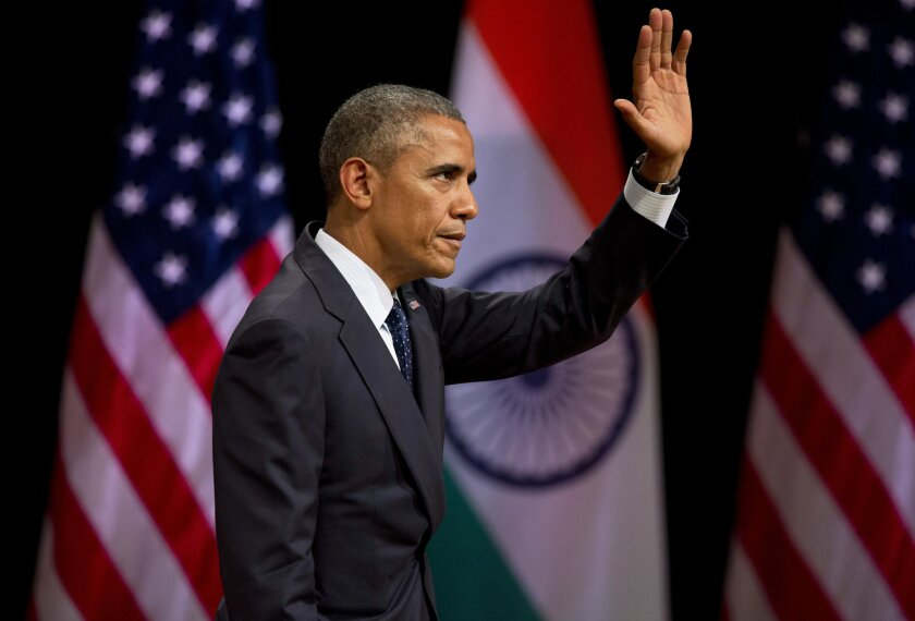 President Obama waves to the audience after delivering a speech in New Delhi on Jan. 27.