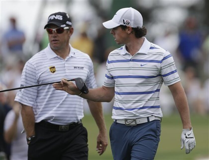 Rory McIlroy, right, of Northern Ireland, and Lee Westwood, of England on the third tee during a practice round for the Masters golf tournament Monday, April 8, 2013, in Augusta, Ga. (AP Photo/David Goldman)