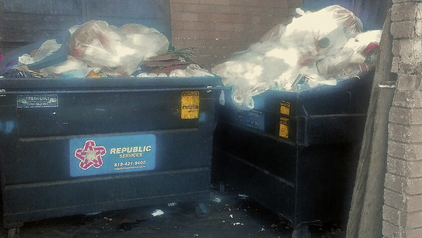 Overflowing dumpsters are seen at Ellen Browning Scripps Park, located in the La Jolla Cove area.