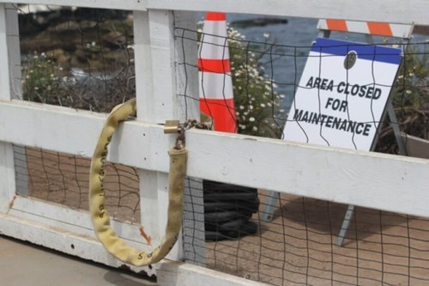City workers locked the gate above La Jolla Cove April 10 while workers applied more microbial foam to rid the bluffs of smelly bird excrement.