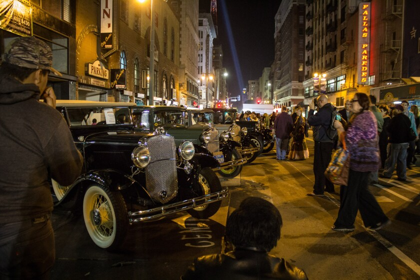 Cars, including a 1931 Chevy Phaeton, left, are on display along Broadway in downtown L.A.