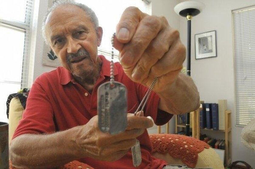 """In this 2008 photograph, Major Morris of Escondido holds his dog tags from World War II, when he was a member of the """"buffalo soldiers,"""" one of the last segregated black divisions in the Army. Morris died June 11, 2016, at the age of 95."""