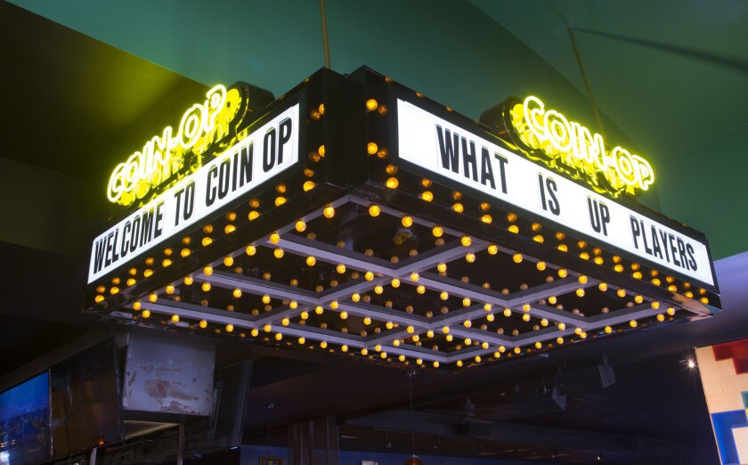 The sign at the front entrance of the newly opened Coin-Op in the Gaslamp Quarter.