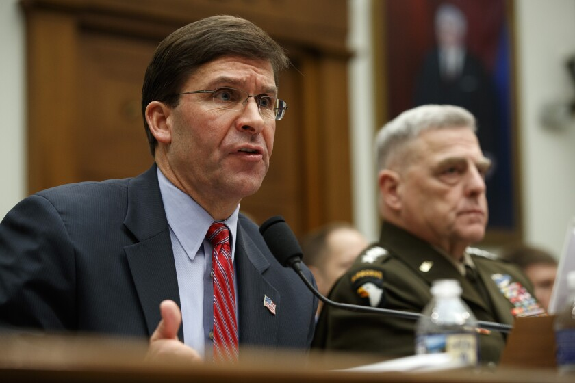 Secretary of Defense Mark Esper, left, and Chairman of the Joint Chiefs Gen. Mark Milley, testify to a House committee hearing on U.S. policy in Syria, Wednesday, Dec. 11, 2019, on Capitol Hill in Washington. (AP Photo/Jacquelyn Martin)