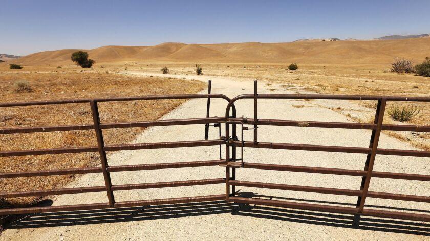 TEJON RANCH, CA – AUGUST 06, 2018: Few dirt roads cut through the flat, windy sprawling grasslands