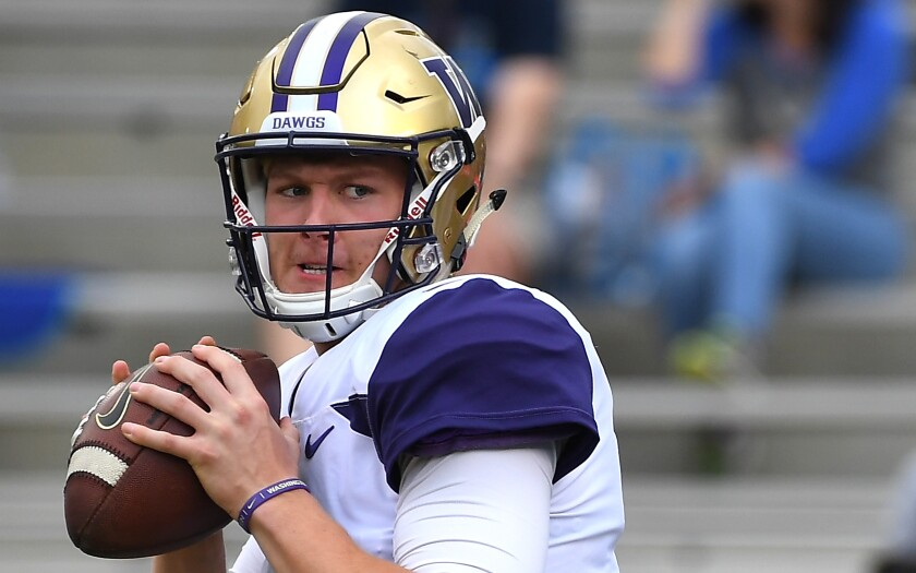 Washington quarterback Colson Yankoff warms up before a game against UCLA in October 2018.