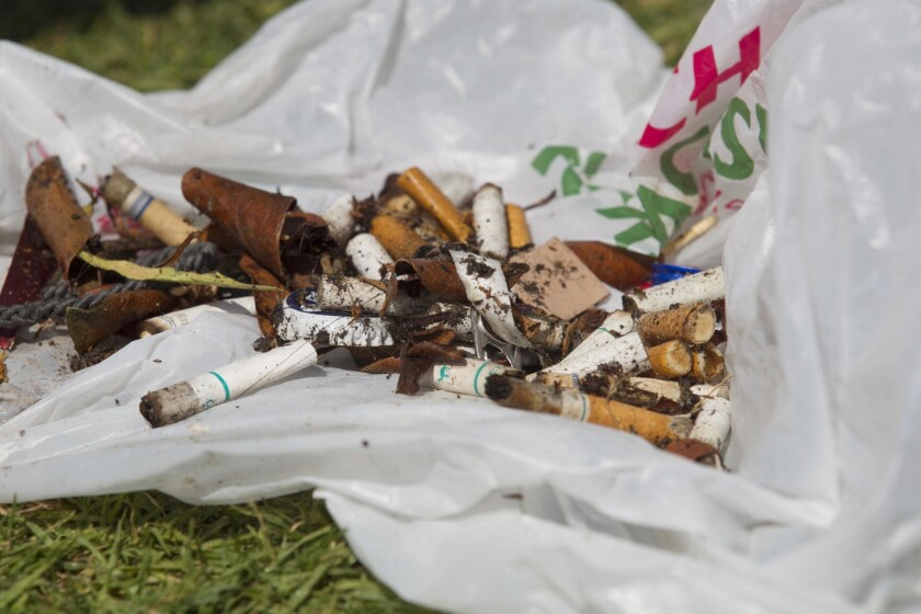 Russ Nicholson from South Park picked cigarette butts that he collected from the beach at Ocean Beach while participating in the Surfrider Foundation's annual post 4th of July clean up.