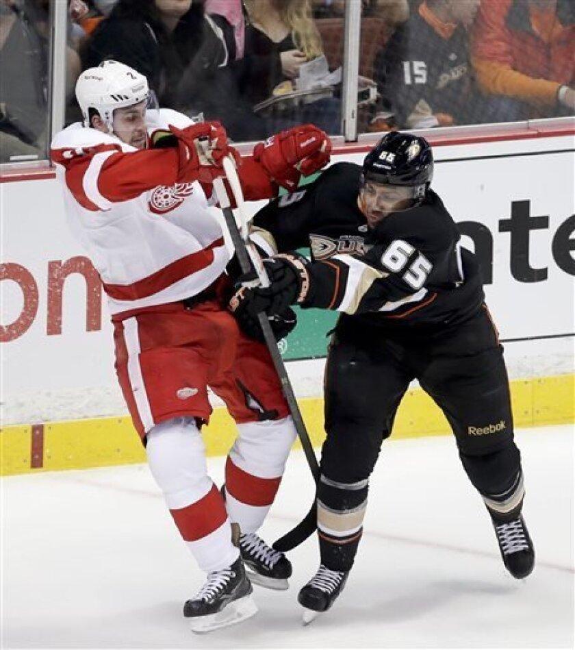 Anaheim Ducks right wing Emerson Etem, right, checks Detroit Red Wings defenseman Brendan Smith during the second period in Game 1 of their first-round NHL hockey Stanley Cup playoff series in Anaheim, Calif., Tuesday, April 30, 2013. (AP Photo/Chris Carlson)