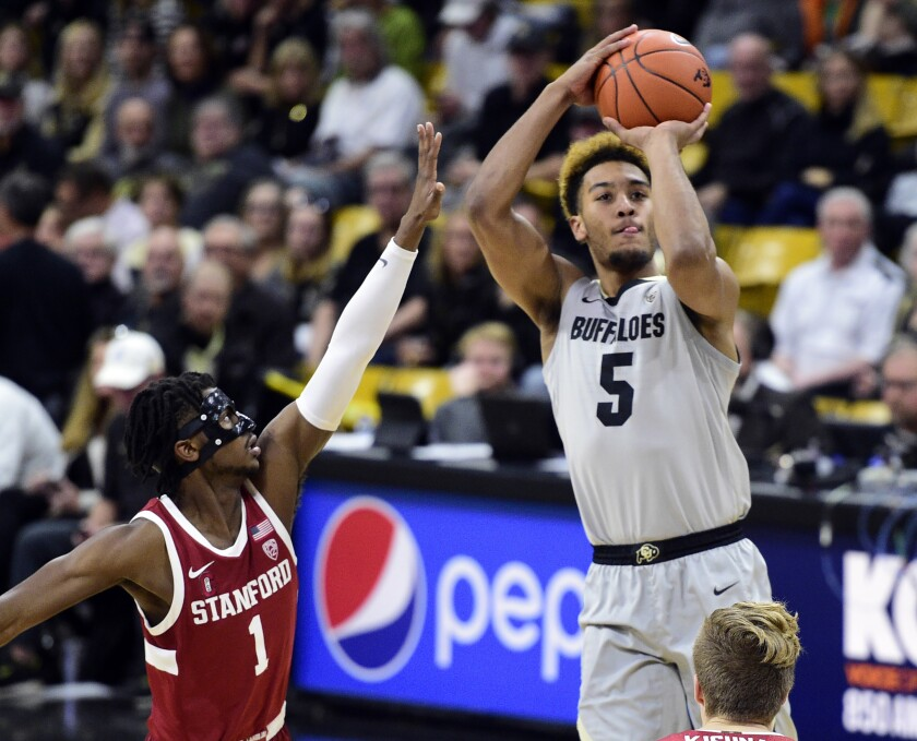 Colorado's D'Shawn Schwartz goes up for a second-half shot over Stanford's Daejon Davis on Feb. 8, 2020.