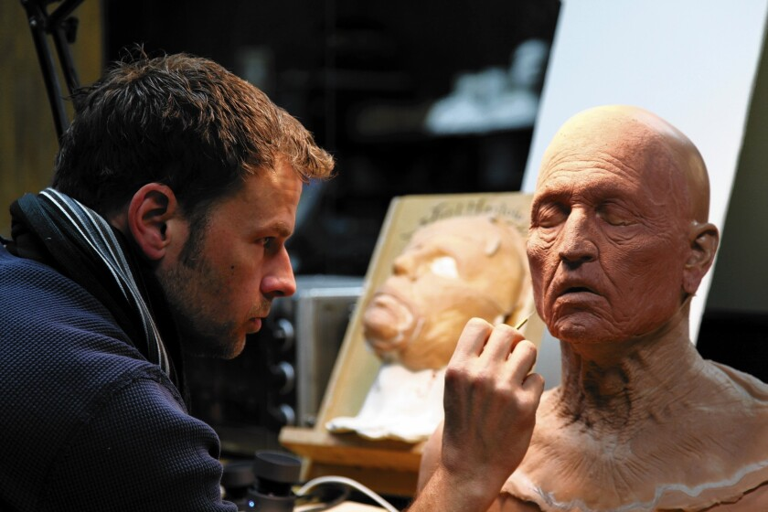 """Makeup artist Joel Harlow sculpts a prosthetic for Tonto, played by Johnny Depp, in Disney's """"The Lone Ranger."""""""