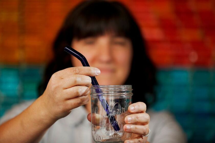 A reusable straw made of blue glass