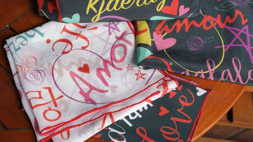 "Angela Coppola's new line of scarves and other items printed with the word ""love"" in several langu"