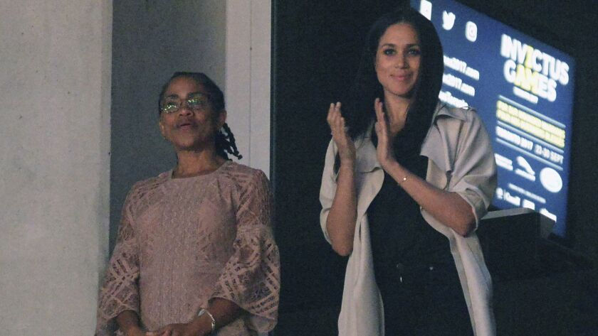 FILE - In this Saturday, Sept. 30, 2017 file photo, Meghan Markle, right, watches the closing ceremo
