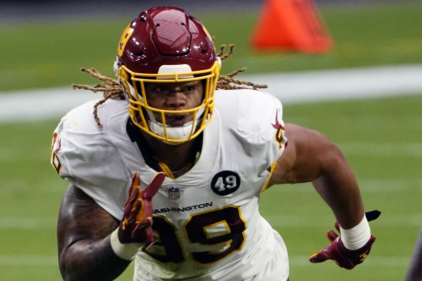 Washington Football Team defensive end Chase Young (99) is shown during an NFL football game against the Arizona Cardinals, Sunday, Sept. 20, 2020, in Glendale, Ariz. The last time Baker Mayfield faced a talented, quarterback-seeking defensive line anchored by the No. 2 overall draft pick, things didn't go well. The San Francisco 49ers menaced and mauled Mayfield last season. On Sunday the Browns' QB faces Washington's ferocious front.(AP Photo/Rick Scuteri, File)