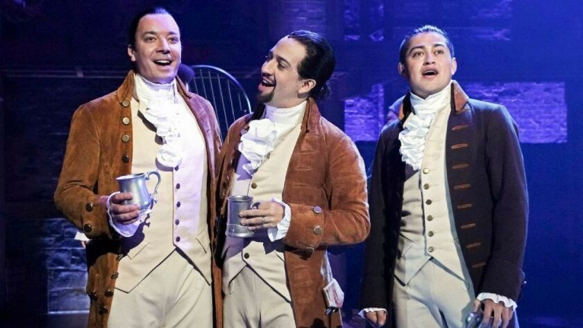 """Jimmy Fallon, left, Lin-Manuel Miranda and a member of the cast from the musical """"Hamilton"""" at the Luis A. Ferré Performing Arts Center in San Juan, Puerto Rico."""