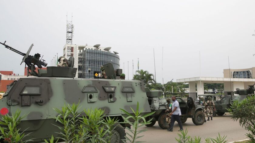 Gabonese soldiers patrol the site of national broadcaster Radiodiffusion Television Gabonaise in Libreville on Monday. Five army officers tried to take over state radio.