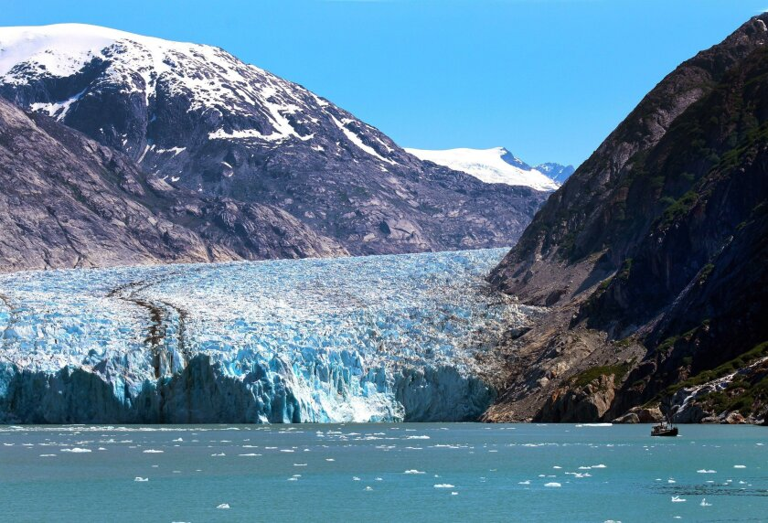 A fishing boat (right) is dwarfed by the Dawes Glacier.  Joanne DiBona photo