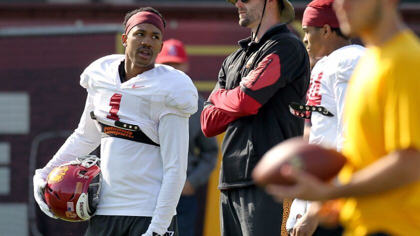 USC cornerback Jack Jones, left, participates in spring practice at USC on Tuesday.
