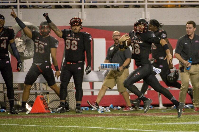 UNLV Rebels quarterback Dalton Sneed (18) runs the ball for a touchdown against the Fresno State Bulldogs during the third quarter at Sam Boyd Stadium.