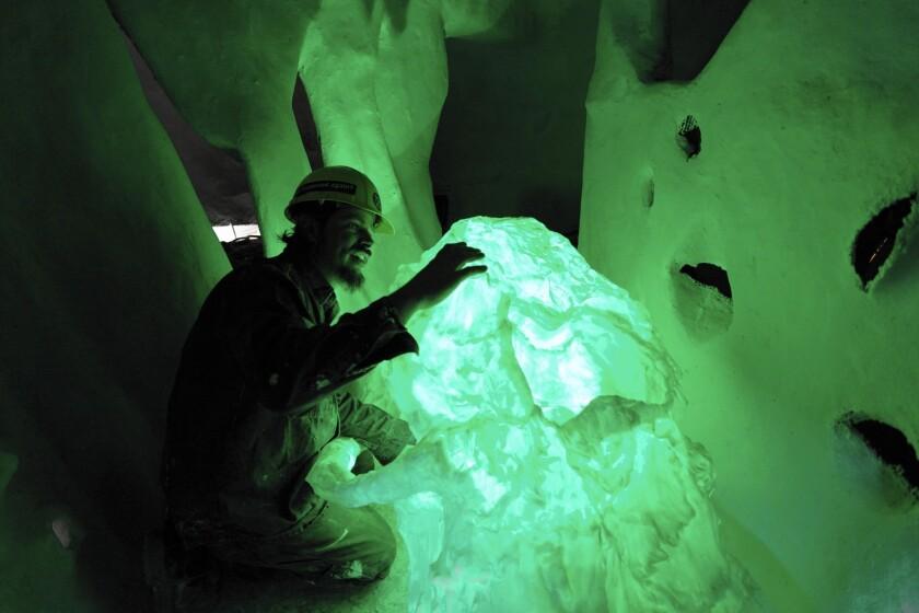 Mat Crimmins tests custom LED lighting for the skull of his 10-foot-tall, interactive mastodon skeleton.