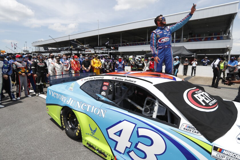 Bubba Wallace takes a selfie with drivers that pushed his car to the front in the pits of the Talladega Superspeedway.