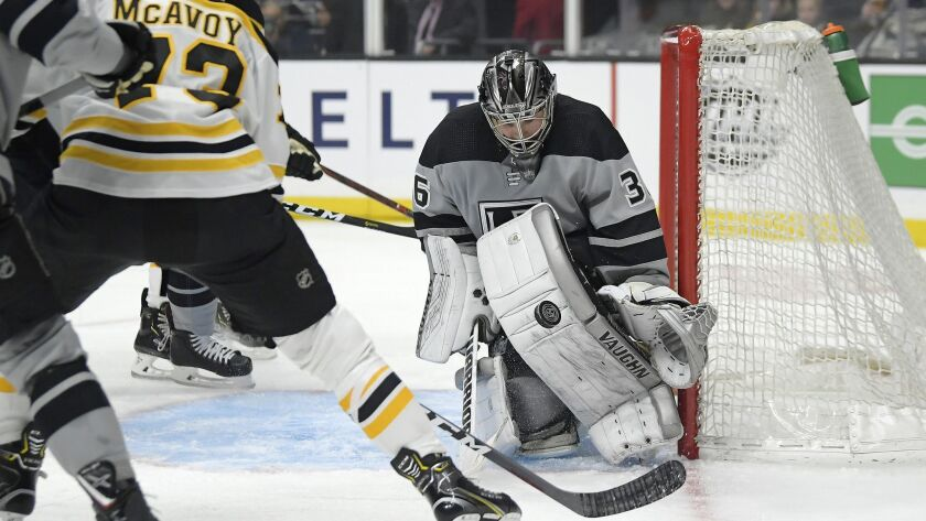 Kings goaltender Jack Campbell, right, stops a shot by Boston Bruins defenseman Charlie McAvoy during Saturday's game. If Campbell got injured in the game, emergency backup Steve Jakiel would have taken his place.