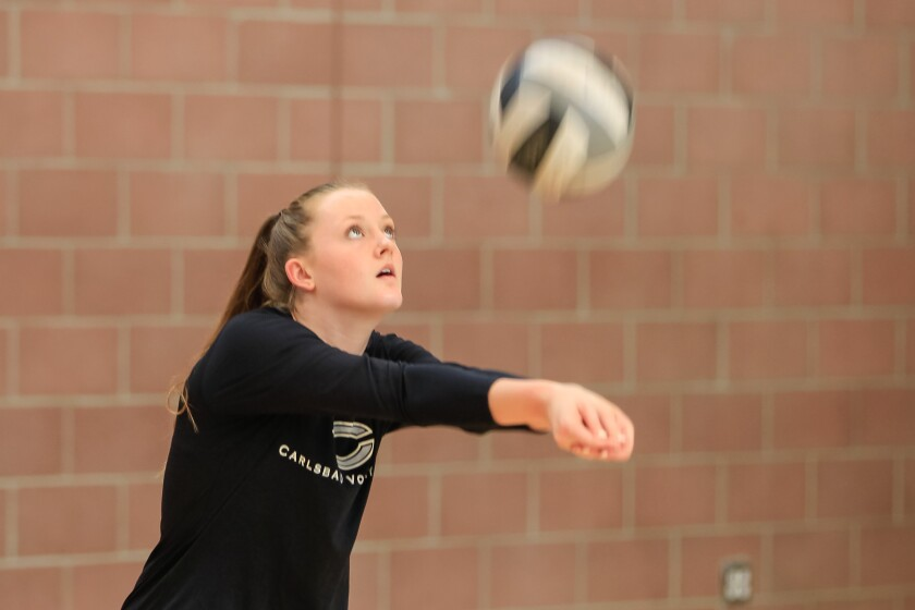 Carlsbad's Mackenzie Karnig (shown last season) led the Lancers with 14 kills.