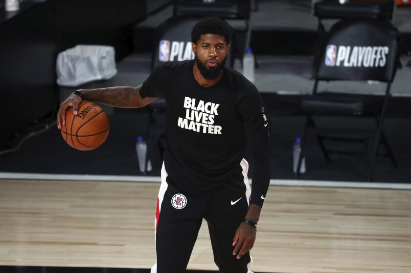 Clippers guard Paul George warms up for Game 5 of an NBA first-round playoff series against the Dallas Mavericks.