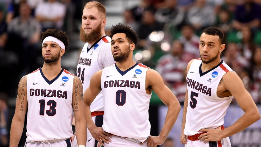 Top-seeded Gonzaga's Josh Perkins (13), Przemek Karnowski (24), Silas Melson (0) and Nigel Williams-Goss (5) came through the NCAA tournament's first weekend unscathed, unlike other highly regarded teams.