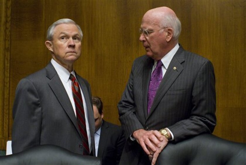 CORRECTS SENATOR LEAHY'S PLAN FOR IMMIGRATION - FILE - In this May 11, 2010 file photo, Senate Judiciary Committee Ranking Member, Republican Jeff Sessions, R-Ala., left, and Democrat Chairman Patrick Leahy, D-Vt., confer before an Immigration hearing on Capitol Hill in Washington. As the Senate Judiciary Committee prepares to begin voting this week on far-reaching immigration legislation, advocates are watching warily to see whether relatively tame opposition balloons into the kind of fierce