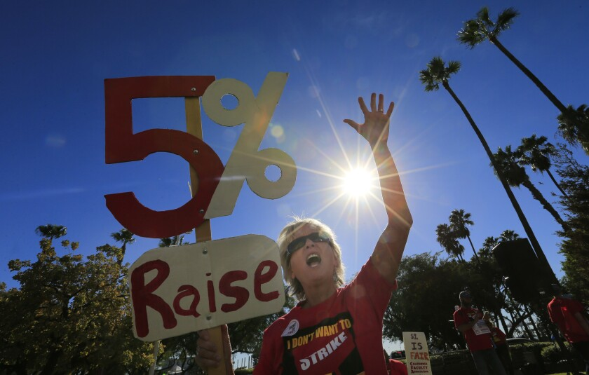 Cal State Fullerton English teacher Michelle Luster joins hundreds of faculty members rallying for pay raises outside a Board of Trustees meeting in Long Beach in November.