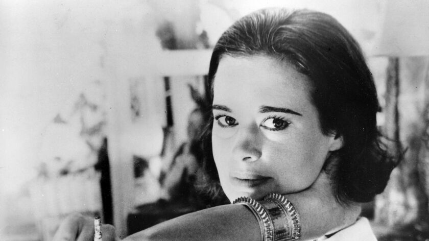 FILE - In this Jan. 4, 1964 file photo, railroad heiress Gloria Vanderbilt poses for a photograph. V