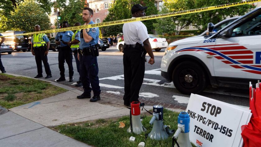 Police secure the street outside the Turkish Embassy in Washington during a visit by Turkish President Recep Tayyip Erdogan on May 16. Turkish security officers were seen hitting and kicking protesters during Erdogan's visit.