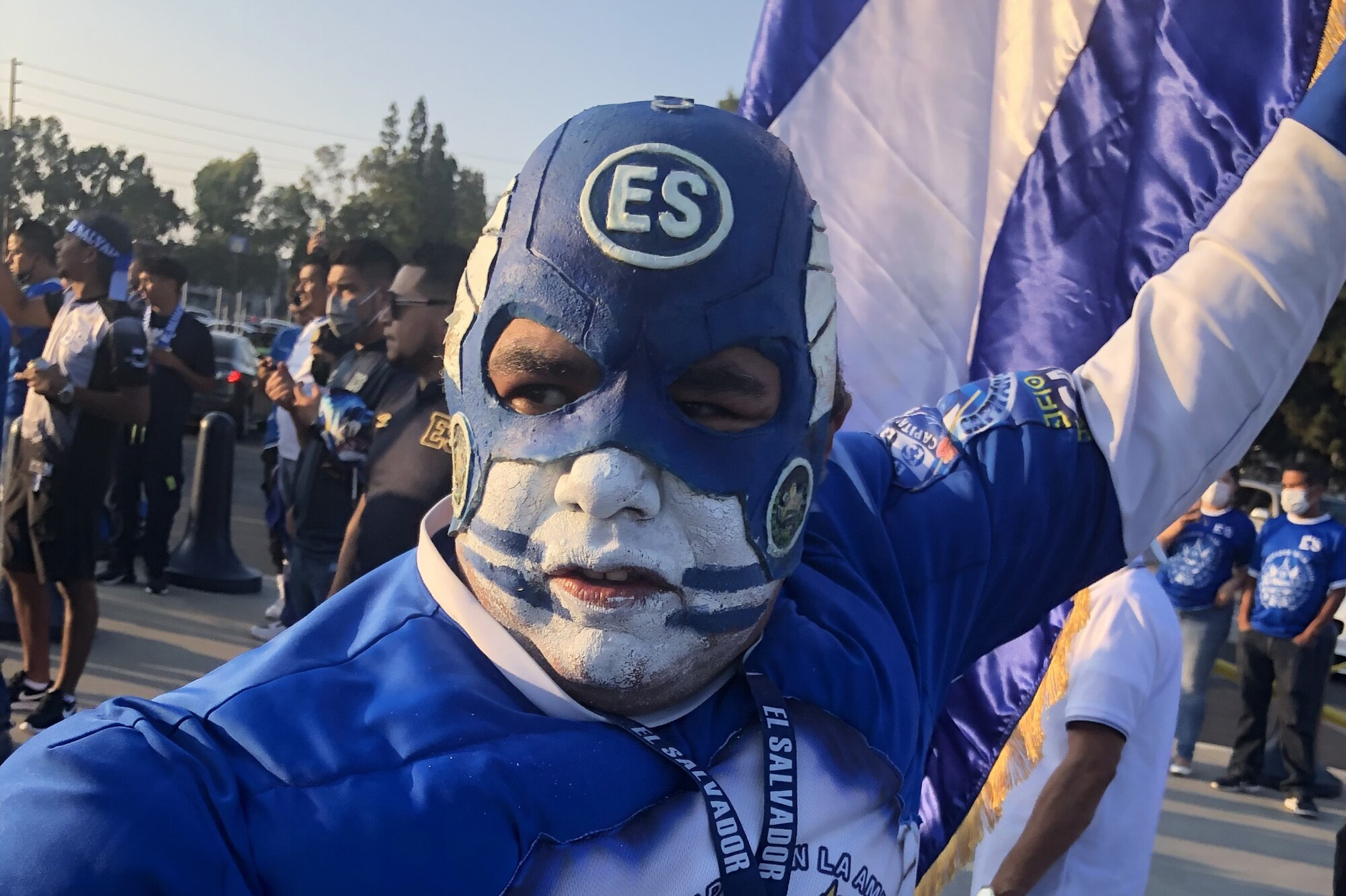 Mario Valladares, of Los Angeles, dresses up as Capitan Cuscatleco and waves the Salvadoran flag