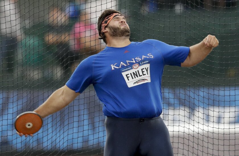 Mason Finley competes during the men's discus throw final at the U.S. Olympic Track and Field Trials, Friday, July 8, 2016, in Eugene Ore. (AP Photo/Charlie Riedel)