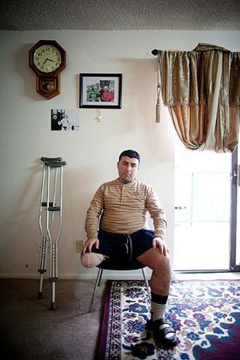 """Iraqi interpreter Malek Hadi lost his leg in a 2006 blast while assisting the U.S. military police. He now lives in Arlington, Texas, on $612 in monthly disability payments. """"When we were in Iraq, we were exactly like the soldiers,"""" Hadi said. """"Why are we treated differently now?"""""""