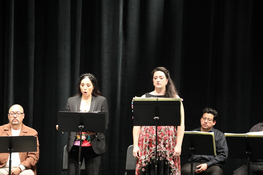 "Darryl Taylor, left, Guadalupe Paz and Tasha Koontz at the workshop performance for ""El Ultimo Sueno de Frida y Diego/The Last Dream of Frida and Diego."""